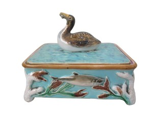 Majolica sardine box with diver finial, by George Jones, circa 1874.