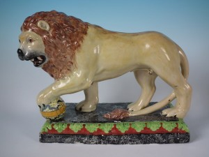 Circa 1780 'Enamel painted figure' of a performing lion.