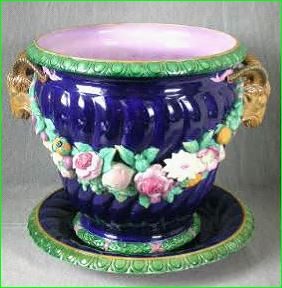 Minton majolica jardinière and stand circa 1861, coloured lead glazes applied directly to the biscuit, shape first introduced at the 1851 Exhibition.