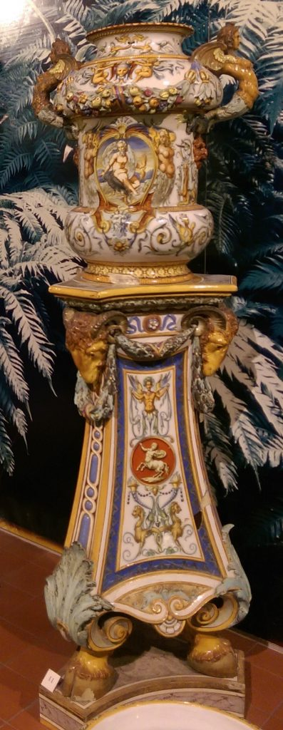 Minton & Co. flower vase and stand, circa 1851, The Potteries Museum & Art Gallery, Stoke-on-Trent. Tin-glazed earthenware, opaque whitish glaze with painted decoration. Minton named this product 'majolica'. Minton's lead-glazed product which they named 'Palissy' ware, also became known as 'majolica'.