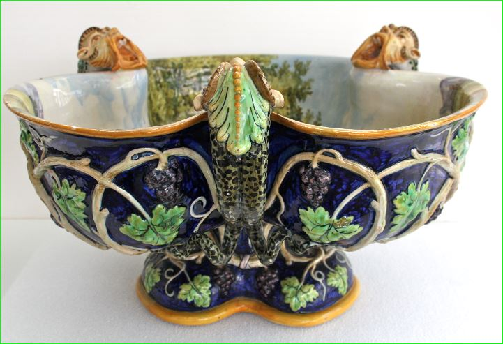 Ginori wine cistern circa 1875. Tin-glazed interior and exterior. Interior with brush painted scene in imitation of 16th century Renaissance maiolica. Exterior with relief decoration, brush painted enamels in imitation of Victorian majolica.