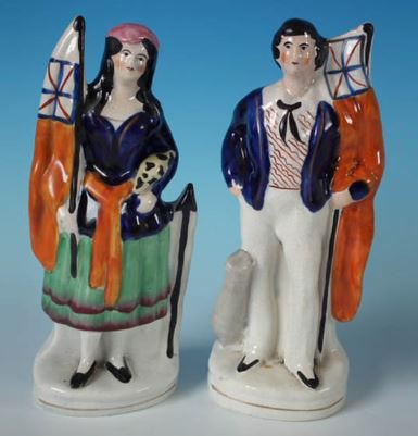 Young girl and young boy pair setting off to the Crimean War. Antique Victorian Staffordshire Pottery Spaniels